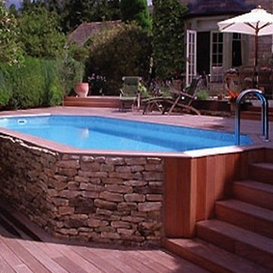 46da21faa22a60f6a1559f9eaa5df85e natural materials thoughtfully positioned on a sloped site make this aboveground pool - Above Ground Pool Deck Off House